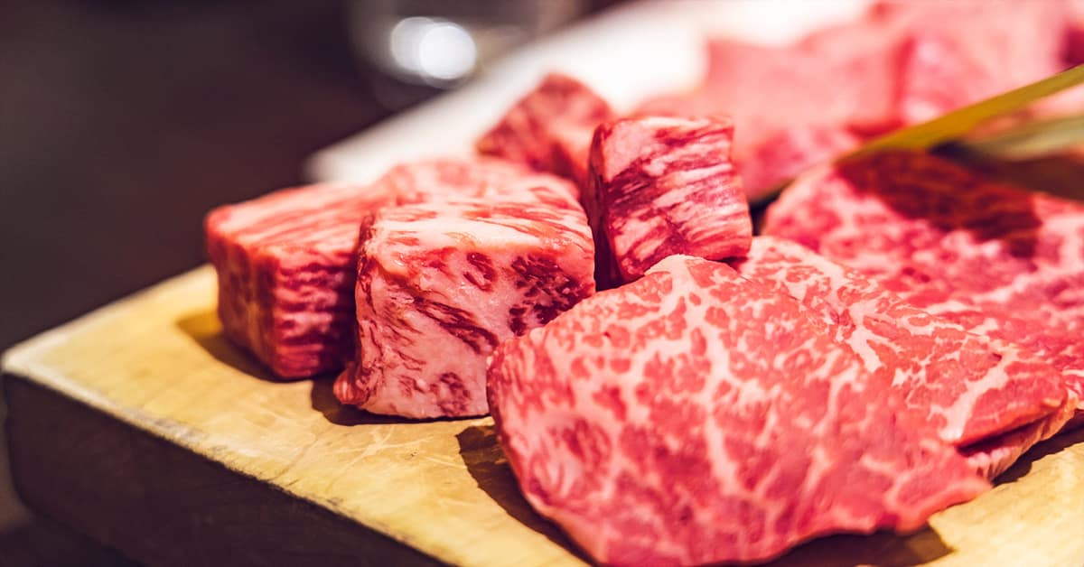 Price of Wagyu beef in Japan - red, raw beef on cutting board