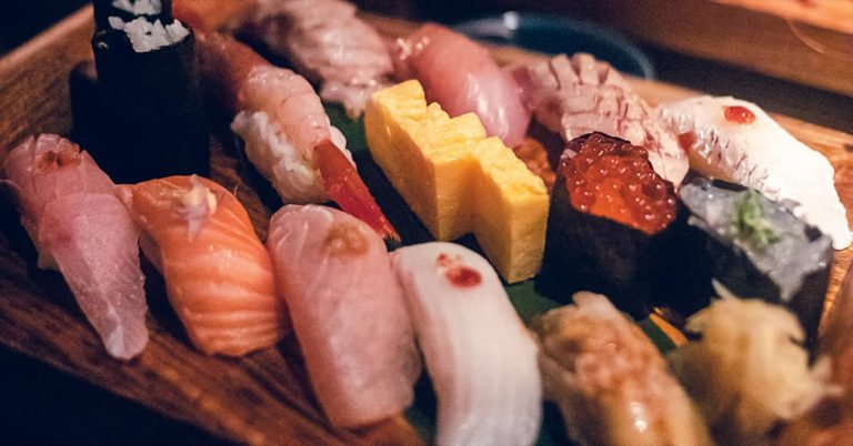 Sushi in Japan, on wood board, variety of toppings