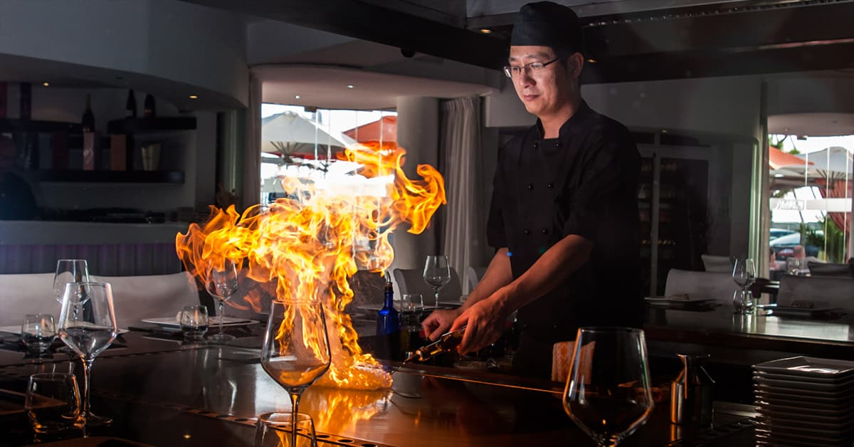 What is Teppanyaki? Flat iron grill on fire with chef