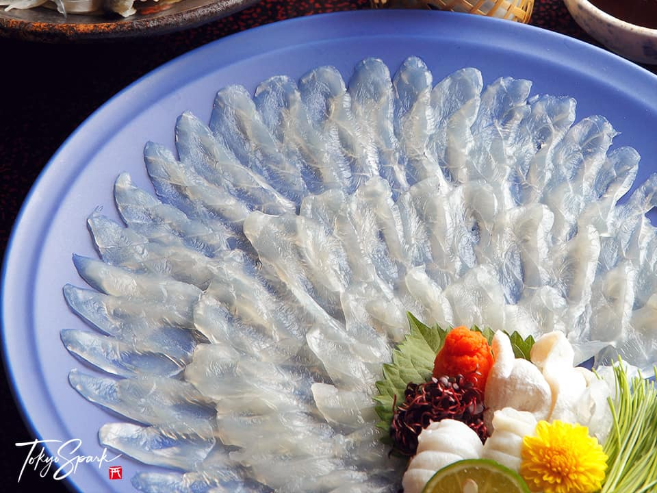 Fugu sashimi on a blue plate