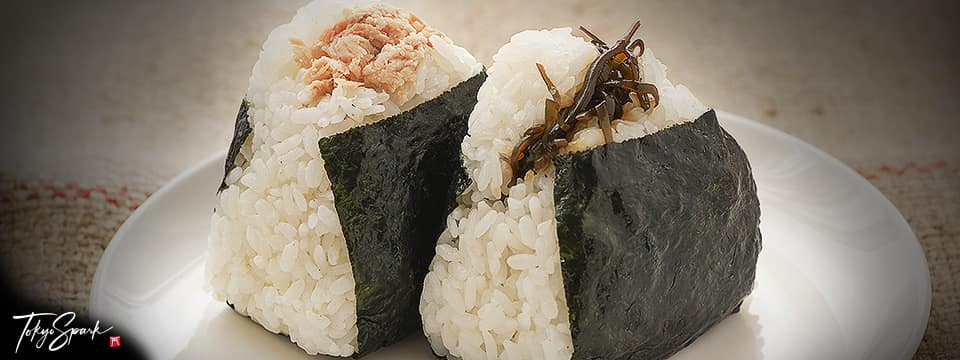 Two onigiri (Japanese rice balls) on a white plate