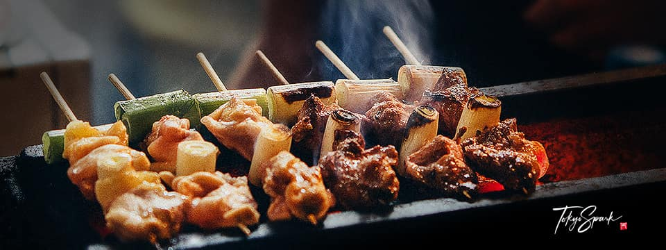 Yakitori, grilled chicken skewers on charcoal grill